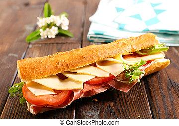 sandwich, baguette with cheese, tomato and prosciutto ham