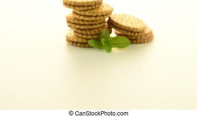 Sandwich biscuits with vanilla filling on a white background