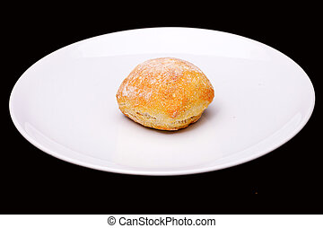 Sandwich bun on white plate