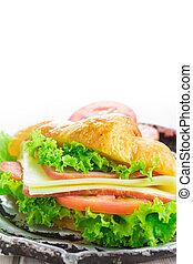 Sandwich croissant on white background