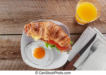 sandwich croissant with fried bacon