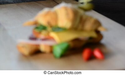 Sandwich croissant,Sandwich with ham,cheese and vegetables
