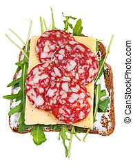 sandwich from bread, salami, cheese, fresh rucola