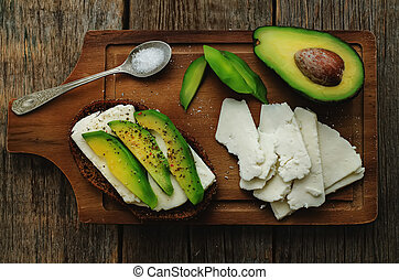 sandwich of rye bread with avocado and goat cheese. tinting....