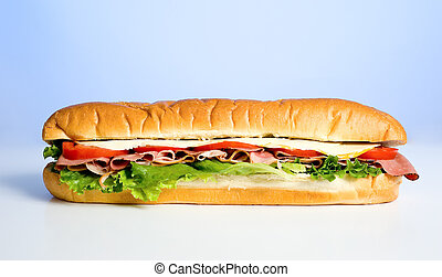 Sandwich on blue - A beautiful meat, lettuce, tomato and ...
