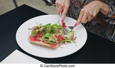 Sandwich on White Plate eaten with Knife and Fork - A...