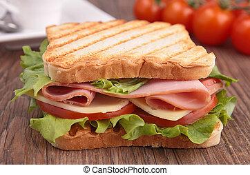 sandwich on wood background