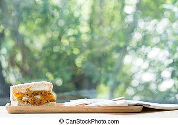 Sandwich on wood tray