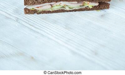 Sandwich on wooden table