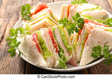 sandwich slices with ham and cheese