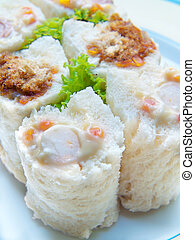 Sandwich sushi rolls salad tuna, ham cheese and dried...