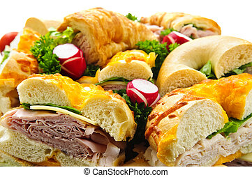 Sandwich tray - Assorted platter of sandwiches with meat and...