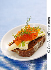 sandwich with caviar on plate