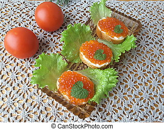 Sandwich with caviar, on plate with lettuce, healthy food