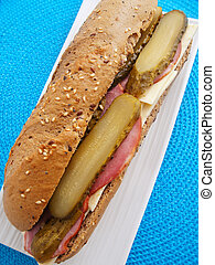 Sandwich with cheese, ham and cucumber