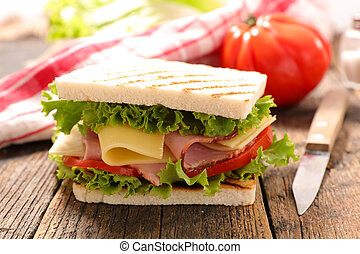 sandwich with cheese, ham and tomato