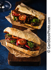 Sandwich with confit duck, Hoisin sauce, cherry tomatoes and chili