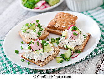 Sandwich with cottage cheese, radish, black pepper and...
