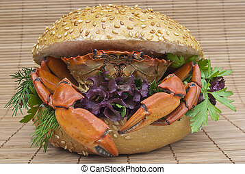 Sandwich with crab on wood background