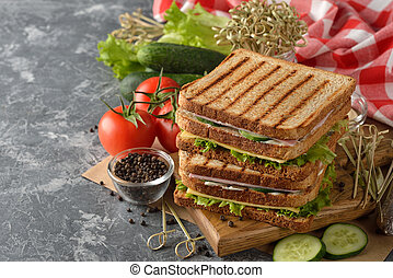 Sandwich with cucumber, cheese and ham