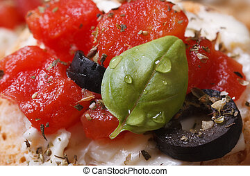 Sandwich with feta, tomatoes, olives and basil. Macro