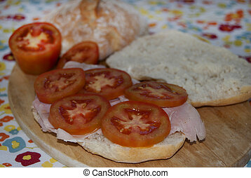sandwich with ham andtomatoes