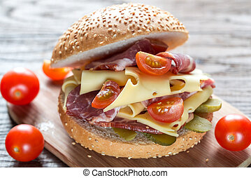 Sandwich with ham, cheese and cherry tomatoes