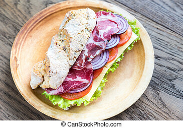 Sandwich with ham, cheese and fresh vegetables