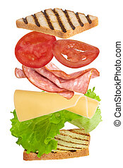 Sandwich with ham, cheese, tomato, lettuce and toasted bread isolated on a white background