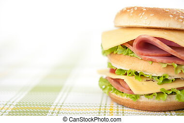 sandwich with ham, cheese, tomatoes and lettuce