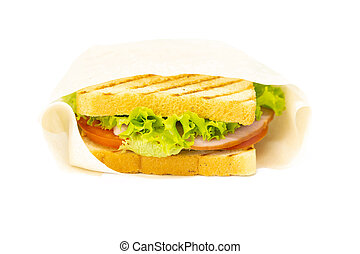 Sandwich with ham, cheese, tomatoes, lettuce, and toasted bread. Front view isolated on white background