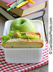 sandwich with ham, green salad