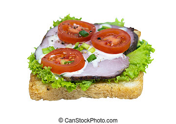 Sandwich with ham, lettuce and tomatoes. Isolated on a white background