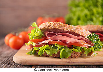 sandwich with ham, tomato and lettuce