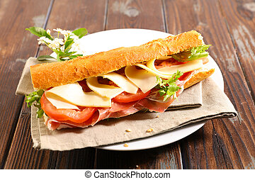 sandwich with ham, tomato and sauce