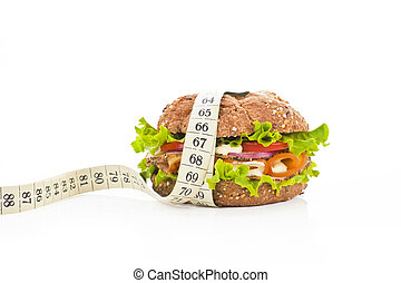Sandwich with measuring tape. Fitness concept.