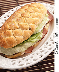 Sandwich with prosciutto and salad