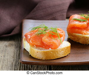Sandwich with red fish (salmon)