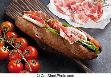 Sandwich with salad, prosciutto and mozzarella