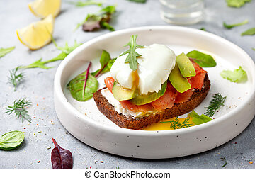 sandwich with salmon, vegetables and egg