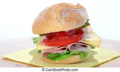 sandwich with sliced turkey, swiss cheese and tomato