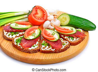 Sandwich with smoked meat and vegetables