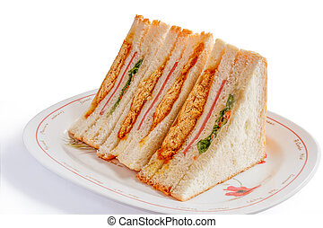 Sandwiches in front of a platter of various fillings