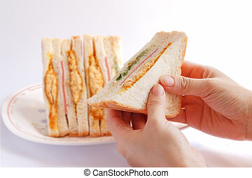 Sandwiches in the woman's hand.