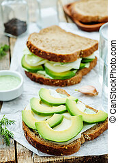 sandwiches with avocado, cheese, cabbage and cheese and herb...