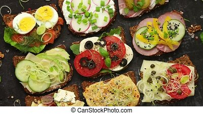 Sandwiches with different kinds of toppings. Placed in rows...