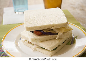 sandwiches with filling of ham and cheese