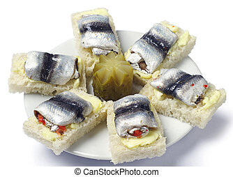 Sandwiches with fish on the plate