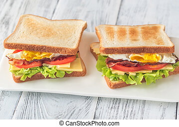 Sandwiches with fried egg and bacon