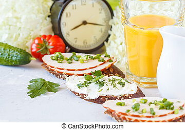 Sandwiches with ham and curd cheese for breakfast